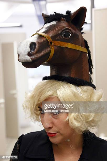 The Italian comic actress Maria Di Biase joking with a blond wig and a false horse head Teatro Camploy Verona June 28th 2011