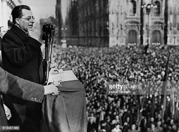 The Italian communist leader Palmiro Togliatti speaks to the huge crowd assembled in Milan's Cathedral Square at the start of the 1946 election...