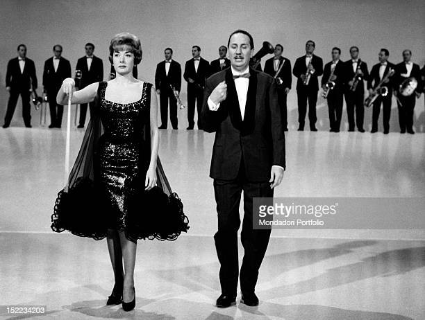 The Italian conductor and composer Gorni Kramer hosting with the Italian actress Lauretta Masiero the TV show 'Alta Fedeltà' January 1962