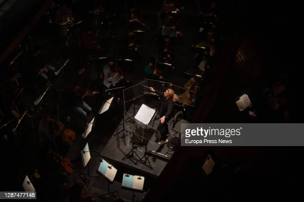 The italian conductor Speranza Scapucci conducts the orchestra during the rehearsal of a scene from 'La Traviata' with piano soloists and chorus from...
