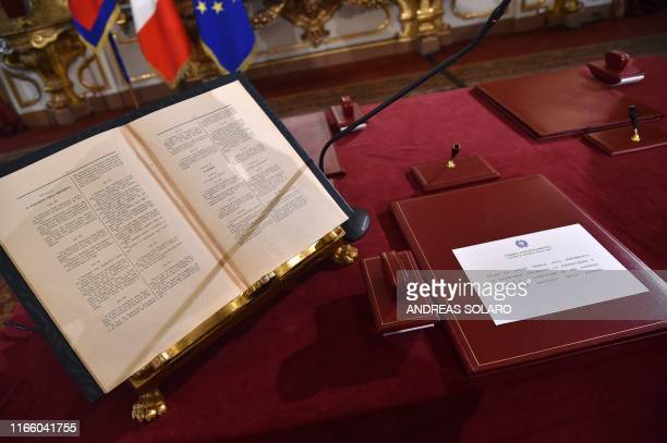 The Italian Constitution and the swearing-in oath are pictured at the desk of Italy's president prior to a new Cabinet swearing-in ceremony at the...