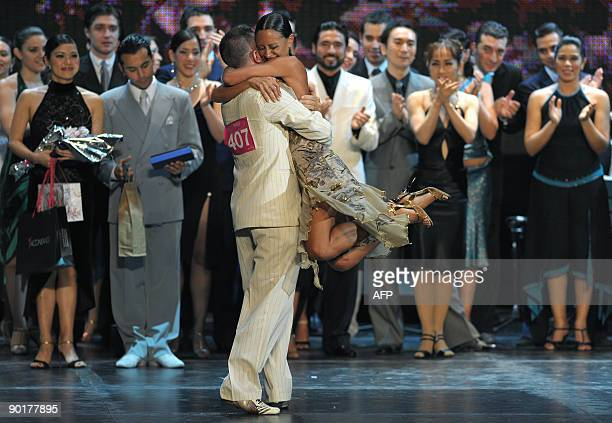 The Italian couple of Sara Masi and Mauro Zompa celebrate after winning the fourth place in the Tango Salon competition during the VII Tango Dance...