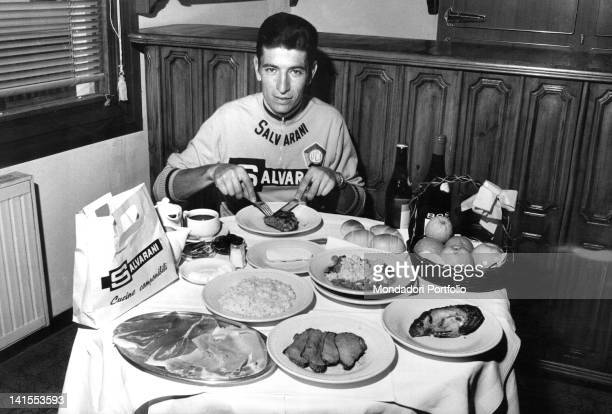 The Italian cyclist Felice Gimondi eating his daily food ration during the Giro d'Italia Sanremo 24th May 1968