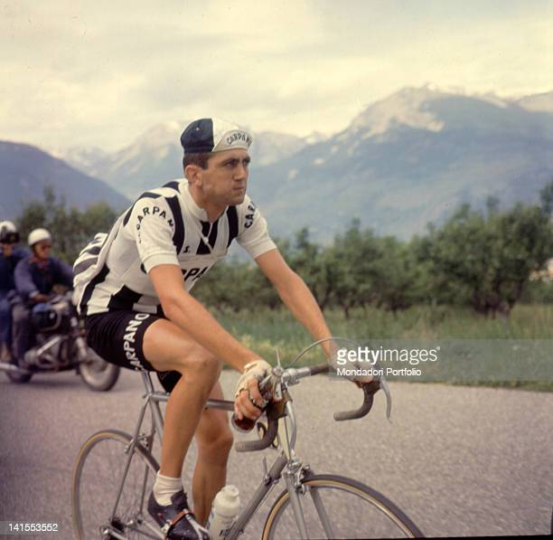 The Italian cyclist Italo Zilioli cycling holding a bottle of Coca Cola during the 21st stage of the Giro d'Italia TurinBiella Piedmont 6th June 1964