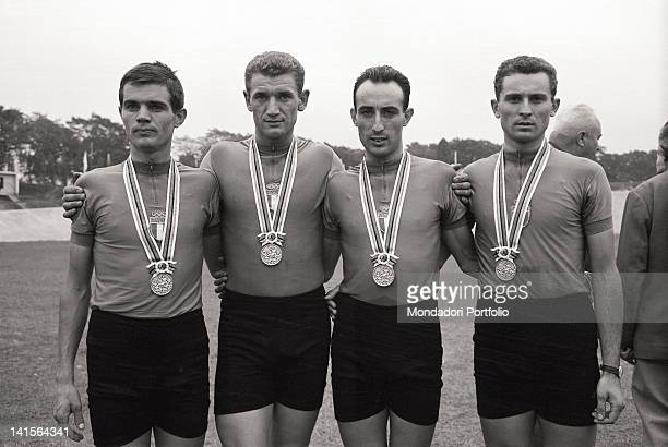 The Italian cyclists Franco Testa Cencio Mantovani Carlo Rancati and Luigi Roncaglia posing with the silver medal they earned at the Tokyo Olympics...