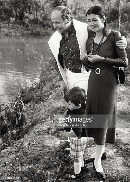 The Italian dancer Carla Fracci her husband Beppe Menegatti and their son Francesco walk along a stream in their farm Tuscany 1972