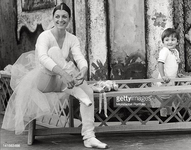 The Italian dancer Carla Fracci with her son Francesco at the Sforza Castle Milan 1973