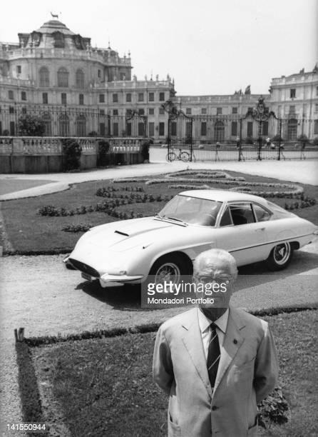 The Italian designer Battista Pinin Farina posing in front of Ferrari 400 Super America car created by him Behind the Hunting Palace of Stupinigi...