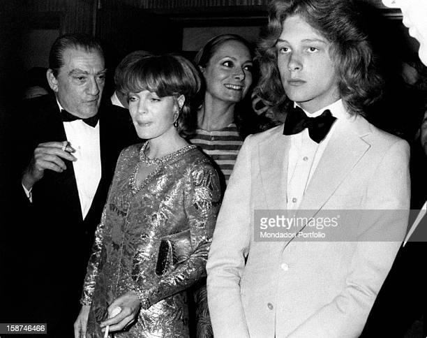 The Italian director Luchino Visconti the Austrianborn French actress Romy Schneider the Italian actress Rossella Falk and the Swedish actor Bjorn...