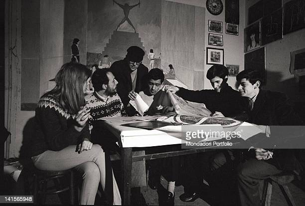 The Italian director Melchiorre Gerbino attending a meeting of 'Mondo Beat' magazine Milan 1960s