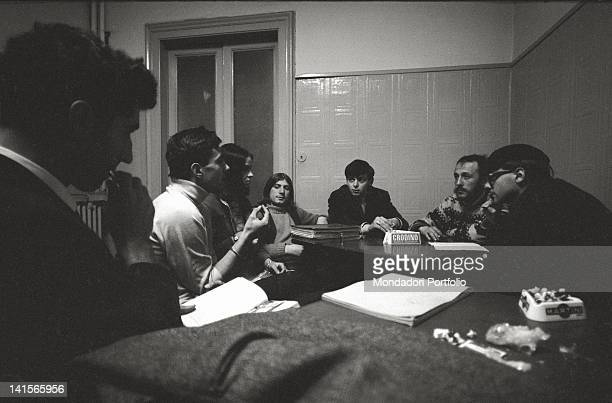 The Italian director Melchiorre Gerbino attending a meeting of 'Mondo Beat' magazine editorial staff Milan 1960s