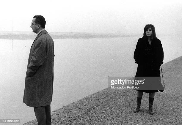 The Italian director Michelangelo Antonioni and the actress Monica Vitti on the bank of a canal in Ravenna