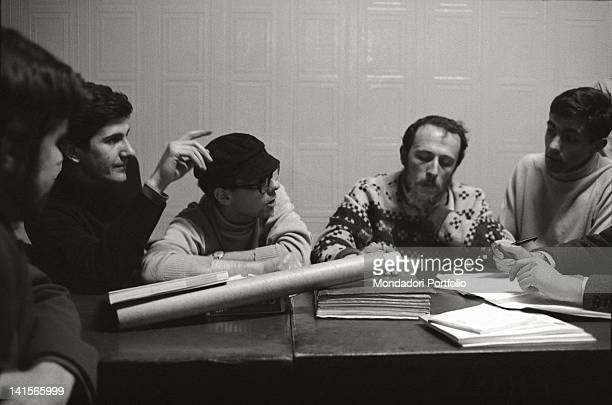 The Italian director of 'Mondo Beat' magazine Melchiorre Gerbino attending a meeting of the editorial staff Milan 1960s
