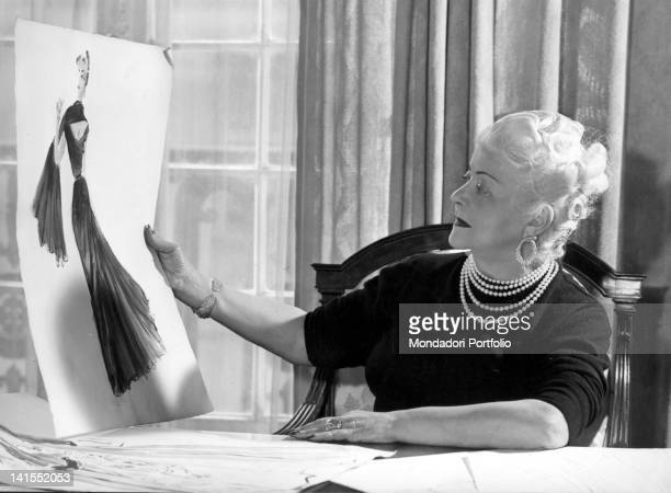 The Italian dressmaker and fashion designer looking at a sketch for a model in her Parisian atelier Paris 1960s