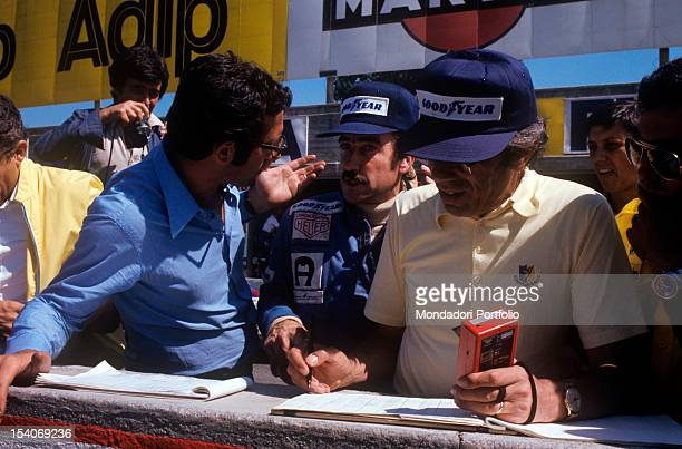 The Italian engineer Mauro Forghieri talking with the Swiss racing car driver Clay Regazzoni during the 45th Italian Grand Prix Monza 8th September...