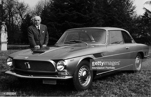 The Italian entrepreneur Renzo Rivolta leaning on the bonnet of a car made by his company 1960s