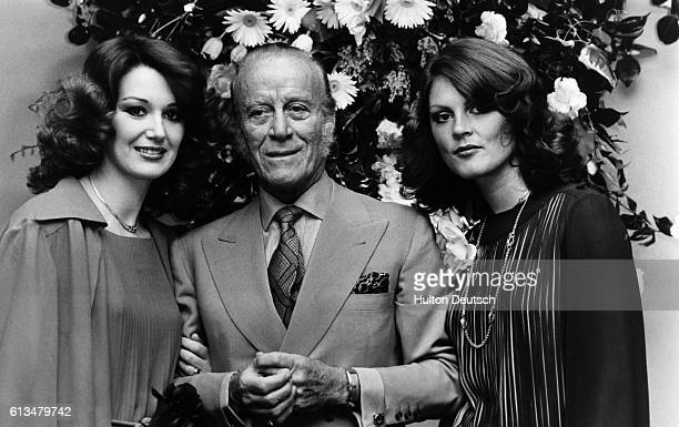 The Italian fashion designer Aldo Gucci with two females at the opening of his new store on Bond Street in London, 1977.