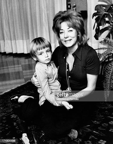 The Italian film theatre and television actress Lauretta Masiero is smiling with her son Gianluca Guidi in her arms whose father is the Italian actor...