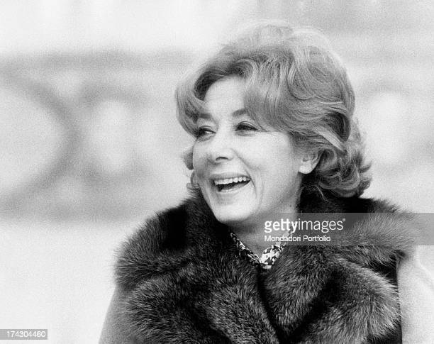 The Italian film theatre and television actress Lauretta Masiero is laughing and wearing a coat with foxfur collar Turin 1973