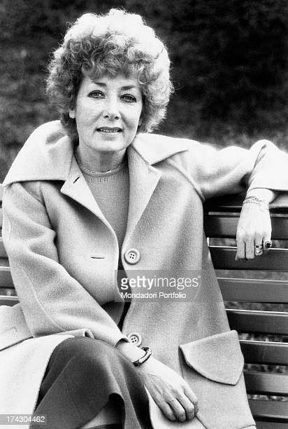 The Italian film theatre and television actress Lauretta Masiero is smiling while she is seated on a park bench of the Margherita Gardens in Bologna...
