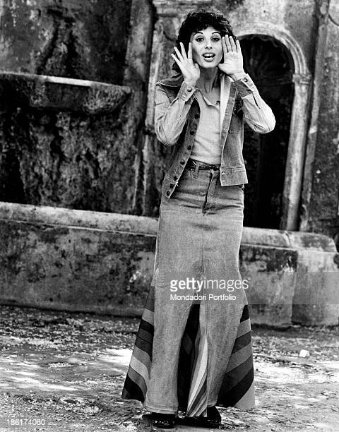 The Italian film theatre and television actress Paola Pitagora is posing in front of the photographer and is pretending to shout at him the actress...