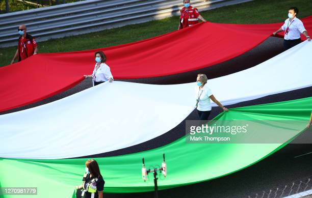 The Italian flag is brought onto the track before the F1 Grand Prix of Italy at Autodromo di Monza on September 06, 2020 in Monza, Italy.