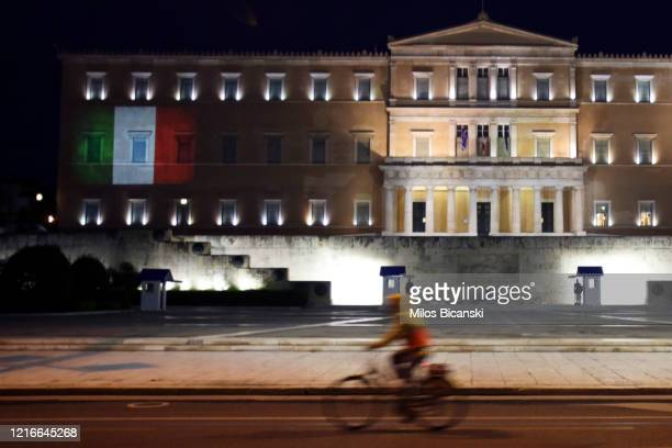 The Italian flag is projected on the Greek Parliament building during a symbolic ceremony in support of the Italian people, on April 3, 2020 in...