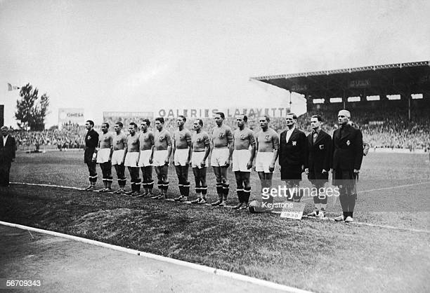 The Italian football team with their coach Vittorio Pozzo before the World Cup final against Hungary at the Stade Olympique de Colombes Paris The...