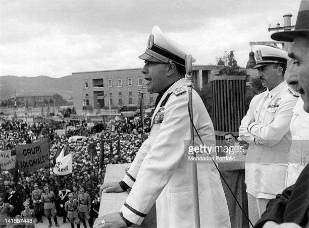 The Italian Foreign Minister Galeazzo Ciano speaking to the crowd gathered in Skanderbeg square, with him the Secretary of State for Albanian Affairs...