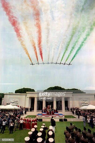 ITA The Italian Frecce Tricolori fly over Nettuno's SicilyRome Cemetery painting the colours of the Italian flag in the air during a ceremony...