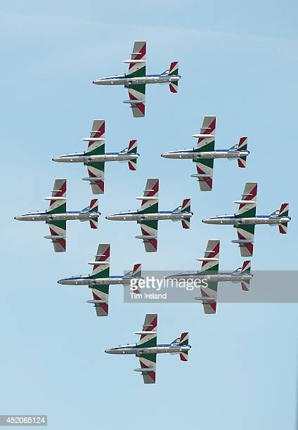 The Italian Frecce Tricolori perform during the Royal International Air Tattoo at RAF Fairford on July 12, 2014 in Fairford, England. The Royal...