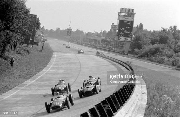 The Italian Grand Prix; Monza, September 2, 1956. Lap 5 of this dramatic race: Moss with the offset-engine Maserati 250F leads the Ferrari-Lancia...