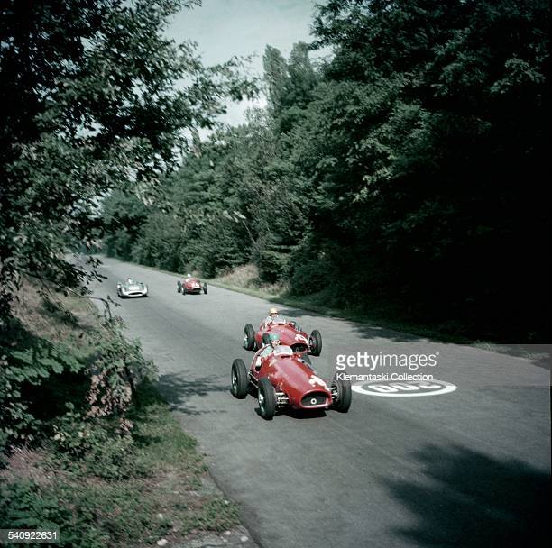 The Italian Grand Prix; Monza, September 5, 1954. The leading group approaches the Porfido corner. First is Alberto Ascari with the Ferrari 625/F1...