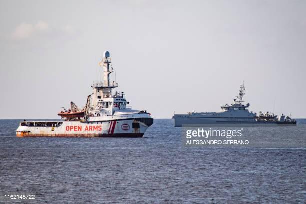 The Italian Guardia di Finanza boat sails towards the Spanish migrant rescue NGO ship Open Arms to retrieve 27 unaccompanied minors and take them to...