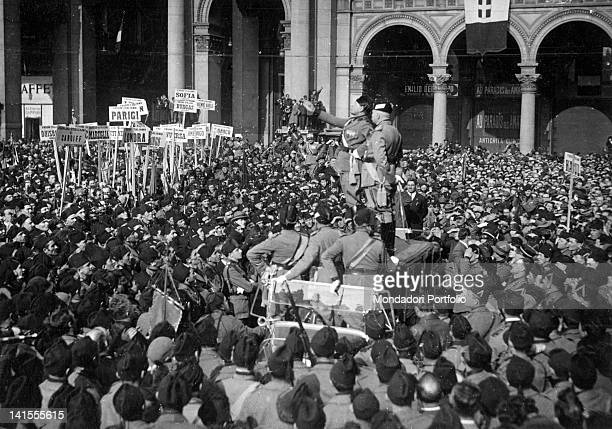 The Italian head of the government Benito Mussolini addressing the crowd from the roof of a car in piazza Duomo on the third anniversary of the March...