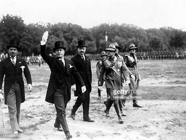 The Italian head of the government Benito Mussolini Italo Balbo and minister Giuseppe Belluzzo inspecting the Forest Militia at the Parco dei Daini...