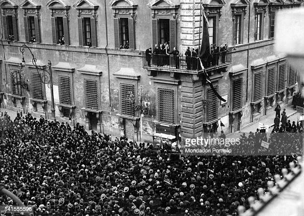 The Italian head of the government Benito Mussolini speaking to the crowd gathered in Piazza Colonna from a balcony of Palazzo Chigi after a period...