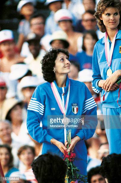The Italian high jumper Sara Simeoni with her german colleague Ulrike Meyfarth attending the prize-giving ceremony of the high jump competition at...