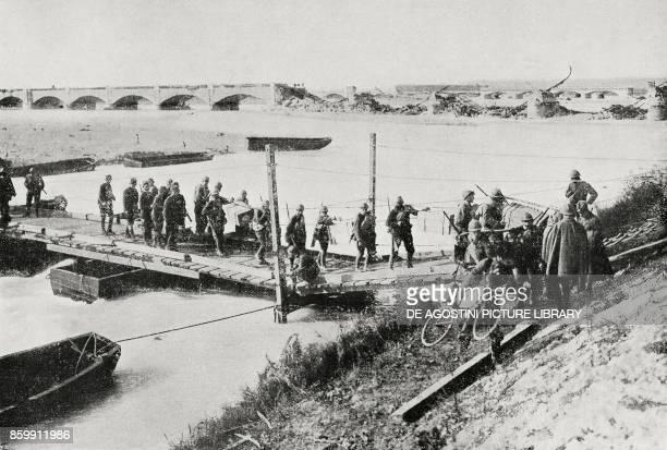 The Italian infantry passing the Piave on a footbridge near the Priula bridge Italy Battle of Vittorio Veneto World War I from l'Illustrazione...