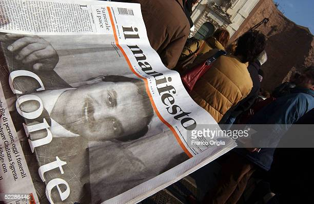 The Italian journal Il Manifesto displays Italian intelligence officer Nicola Calipari on the front cover outside Santa Maria Degli Angeli Basilica...