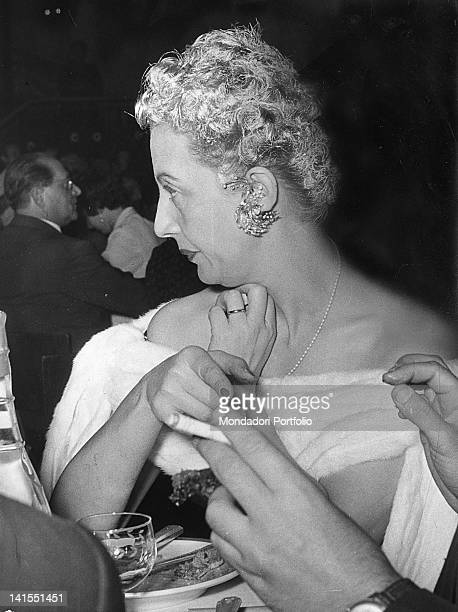 The Italian journalist and writer Irene Brin is sitting at a table during a reception Italy 1950s