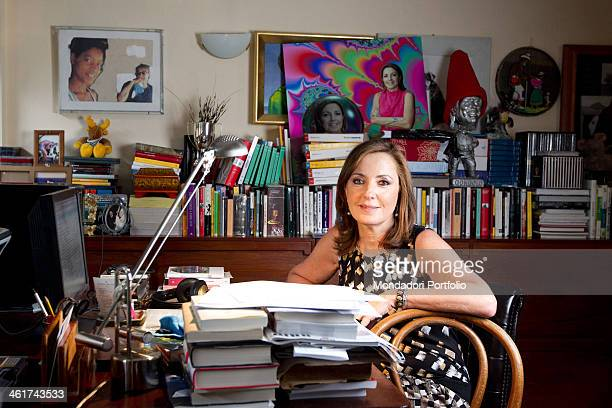 The Italian journalist Barbara Palombelli pose sitting at the desk in her house in Rome Italy Rome April 28 2011