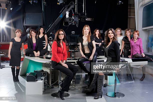 The Italian journalists and presenters of TG1 news posing in the television news studio In the second line fron the left We can recognize Adriana...