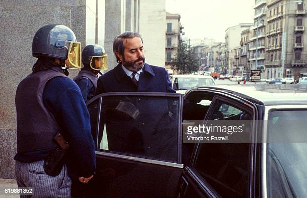 The Italian judge Giovanni Falcone is escorted by police out of the Court of Palermo Italy on May 16 1985 Giovanni Falcone was killed by the Mafia in...