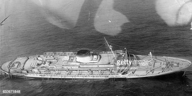 The Italian liner Andrea Doria leans to right as the ship steadily sinks 45 miles off the coast of Nantucket Mass seen in an aerial on July 25 1956...