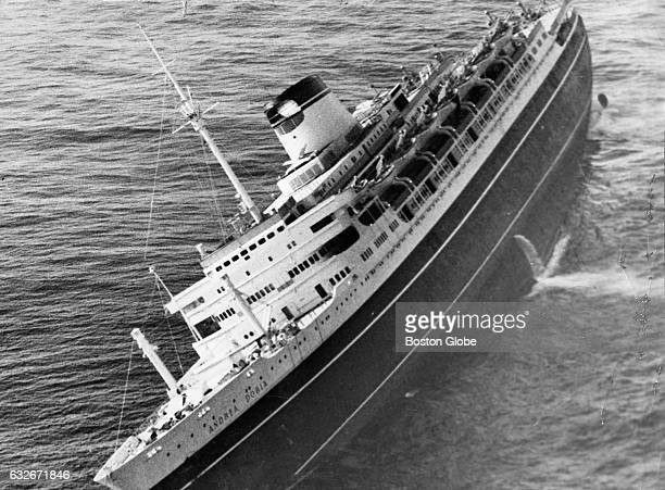 The Italian liner Andrea Doria lists sharply to starboard just before it sank into the water 45 miles off the coast of Nantucket Mass seen in an...
