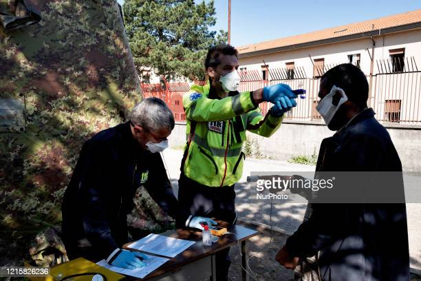 The Italian medical staff of 118 check the state of health of a migrant in the police station of the Italian border town Fernetti to prevent the...