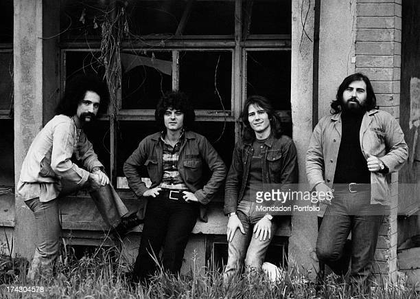 The Italian melodic rock band I Camaleonti are posing in front of a ruined farmhouse in the province of Milan from left Livio Macchia Antonio...