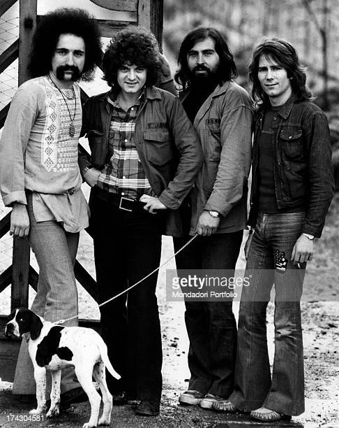 The Italian melodic rock band I Camaleonti are posing in front of a wooden gate of a farmhouse in the province of Milan from left Livio Macchia...