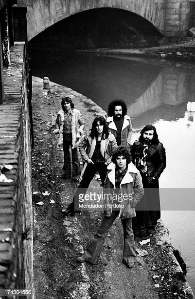The Italian melodic rock band I Camaleonti is posing along the canals of Milan the band is composed again of five elements with the musician Dave...